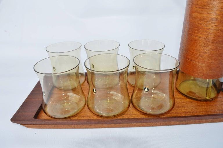 Mid-Century Modern Goran Warff Pukeberg Amber Glass Pitcher & Six Glasses, Stir Stick & Teak Tray For Sale