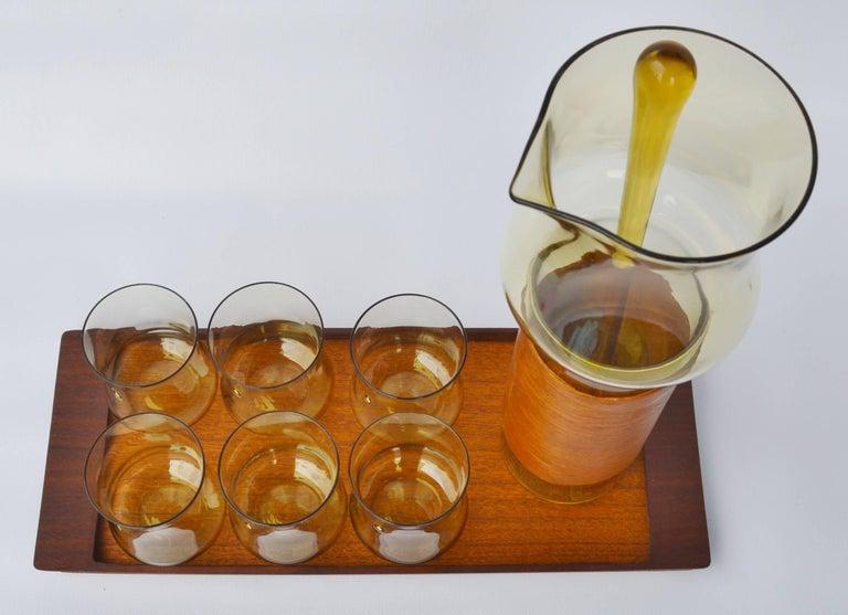 Swedish Goran Warff Pukeberg Amber Glass Pitcher & Six Glasses, Stir Stick & Teak Tray For Sale