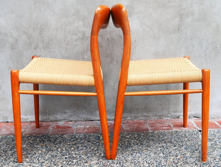 This stunning set of four sculptural solid teak dining chairs by Niels Otto Moller were designed in the 1960s and manufactured by J.L. Moller (note the maker's medallion under the chairs). Completely restored - reglued, freshly oiled, with new woven