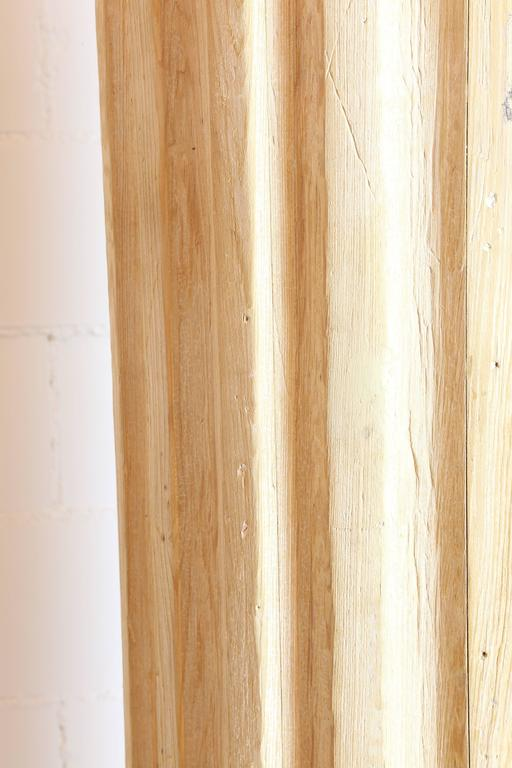 A pair of tall architectural pine fluted columns on a circular base. Separate top piece.