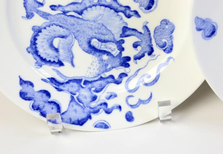 A set of four plates in the blue and white dragon pattern by Coalport.