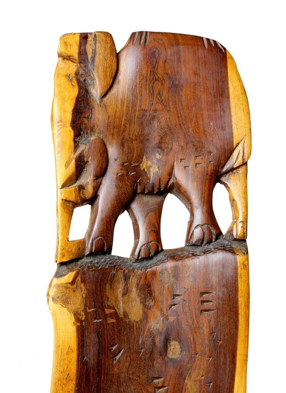 African Two-Piece Small Carved Paddle Chair with Elephant Carving In Good Condition For Sale In Austin, TX