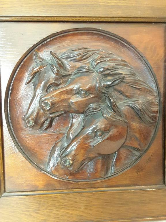 A nice three horse carved pine panel mounted in oak frame signed W.B.Lintton, The horses are deeply carved In a round recessed disc. The carving is signed on the lower right, W. B. Litton. The carving is mounted in a quarter cut oak frame. The