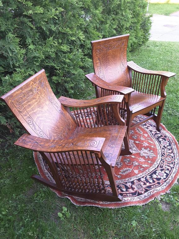 A matched pair of quarter cut sawn oak bentwood carved chairs, One is an armchair the other is a rocker, both are quarter cut oakwood with turned spindles and bentwood seats, backs and arms, carved pattern on all pieces, Both have turned spindles