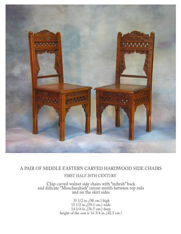 Pair of middle eastern carved hardwood side chairs for
