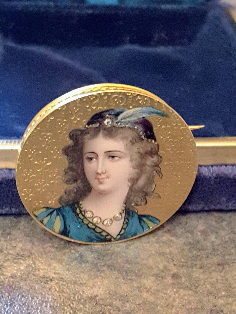 Art Nouveau enameled and diamond 14K gold brooch, Austrian, fine detailed enamel/painted figure, with five-mine cut diamonds, four-around neck for necklace and a single stone on the feather tiara. Brooch is tested as 14-karat gold (not marked) but