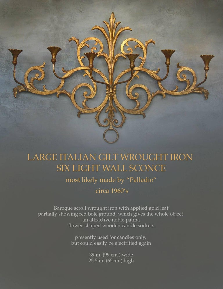 A large Italian gilt wrought iron six-light wall candle sconce, most likely made by
