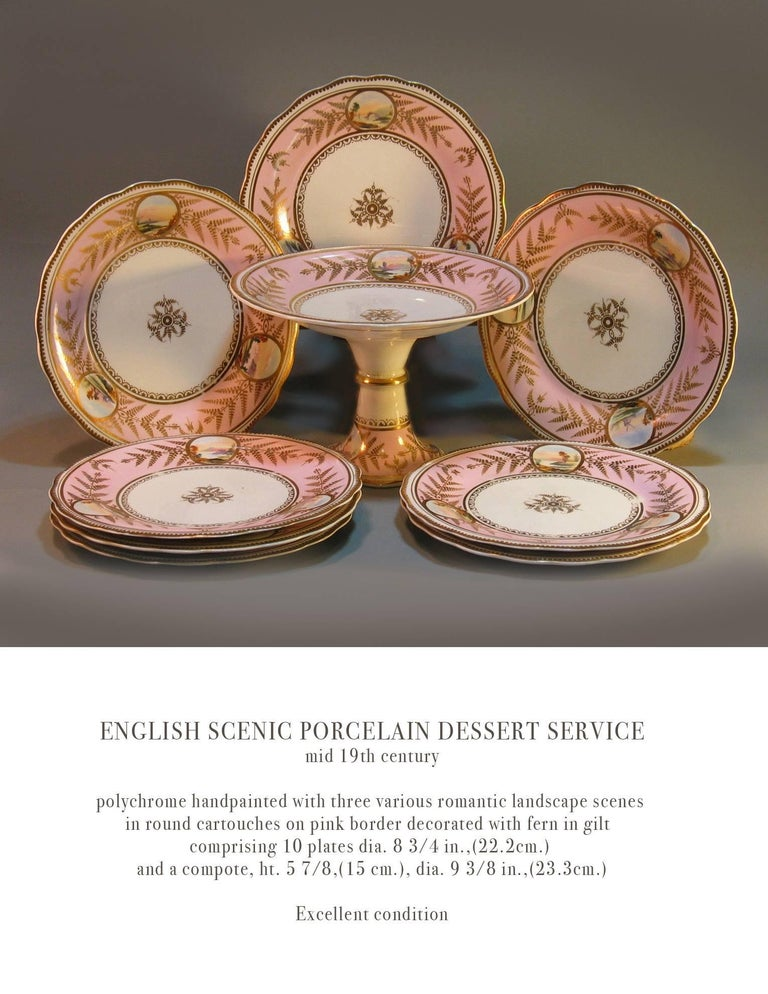 English Scenic porcelain Dessert service, mid-19th century, polychrome hand-painted with three various romantic landscape scenes in a round cartouches on a pink border, decorated with fern gilt decoration. Comprising of ten plates and a compote. The