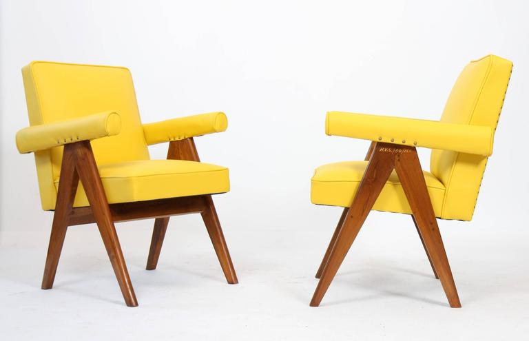 "Set of two ""Senate-committee"" teak chairs, flat inclined backrest, compass base with tapered legs.