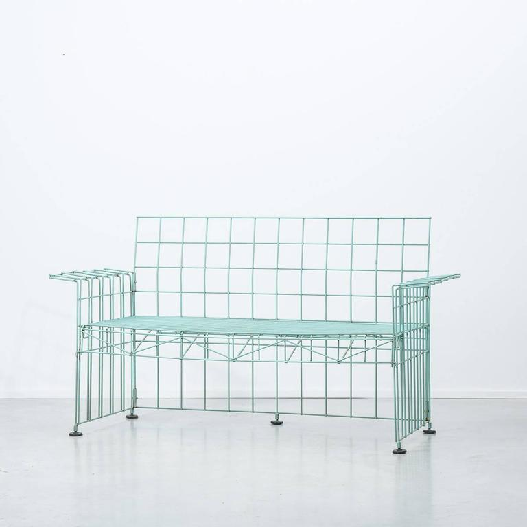 This Abitacolo sofa was designed by Bruno Munari and produced by Robots in Italy in 1972. The frame is made from green lacquered metal and the style vehemently postmodern. It remains in a good vintage condition and it comes with the original pale