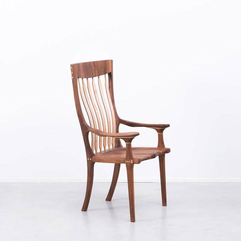 A large hall chair of exceptional quality inspired by the designs of Sam Maloof. Little is known about the maker other than he is a South coast (England) artist who hand made the chair around 20 years ago and sked that his identity not be