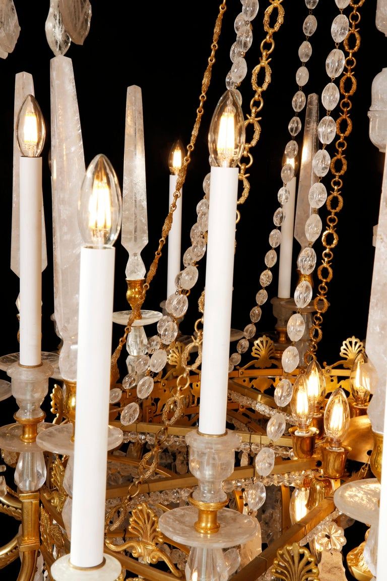 Contemporary Monumental Pair of Hand-Carved Rock Crystal, Bronze and Ormolu Chandeliers For Sale
