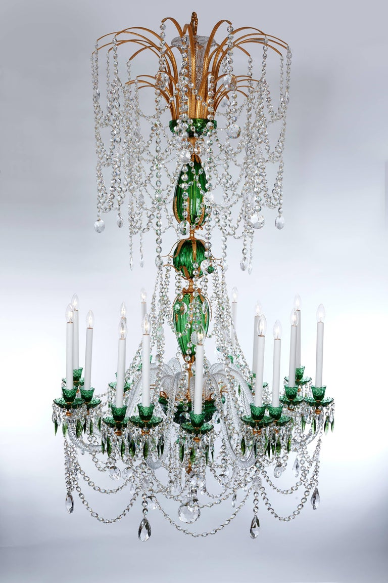 A rare pair of magnificent green and clear crystal chandeliers, in the Russian style, comprised of 16 arms hung with swags and chains of button drops, supported with rope twist clear glass arms emanating from a magnificent ormolu centre, comprised