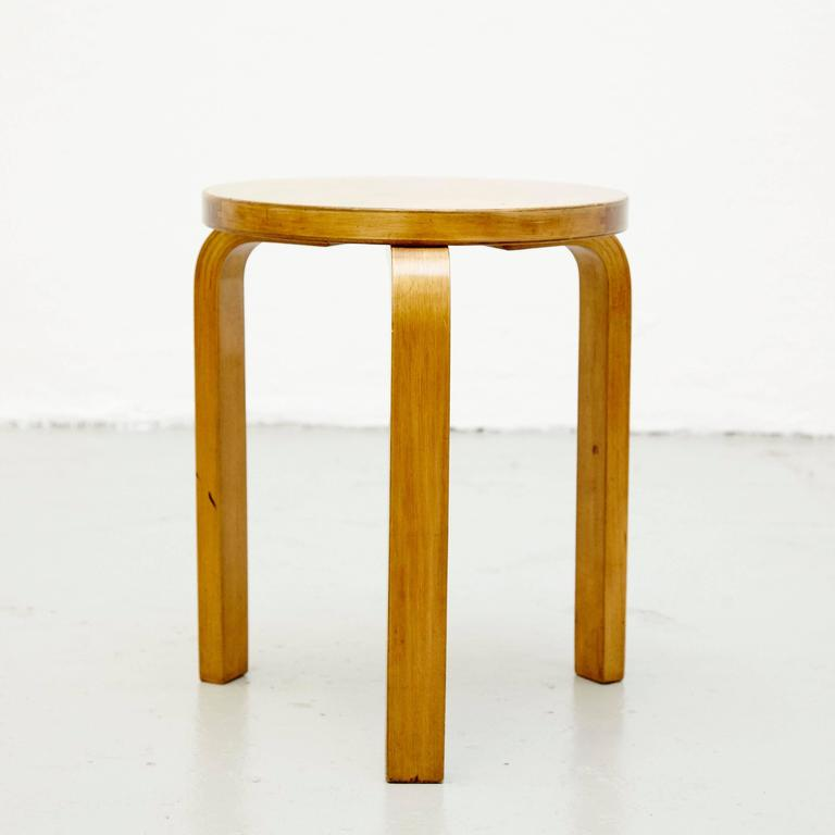 Stool designed by Alvar Aalto, circa 1930. Manufactured by Artek (Finland) Distributed by Finmar (England). Wood legs and structure. Labelled to the underside.  This wood stool is designed by the designer Alvar Aalto. It is a round shaped stool with
