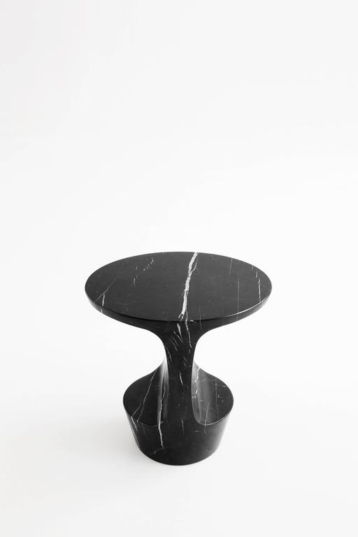 Atlas is a side table made out of a Marquina marble block, extracted in the North of Spain. The piece takes its name after the young titan of the Greek mythology that was fated to sustain the pillars that separated the Earth from Heaven and its