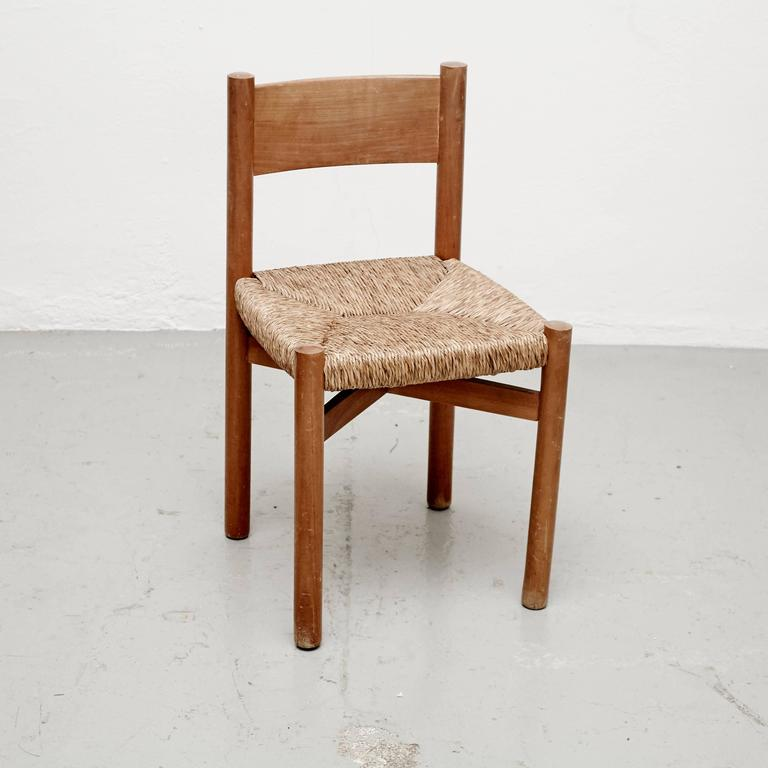 Chair model Meribel, designed by Charlotte Perriand, circa 1950, manufactured in France.  Wood and rattan.  In good original condition, with minor wear consistent with age and use, preserving a beautiful patina.  Charlotte Perriand (1903-1999)