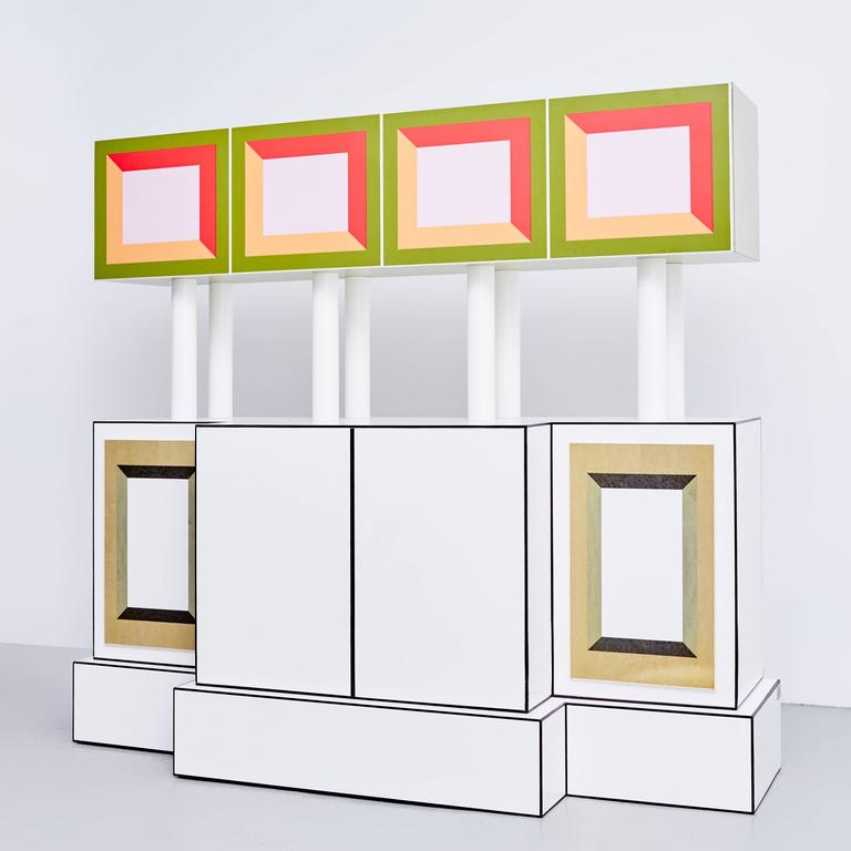 Piccoli Libri cabinet designed by Ettore Sottsass in 1992 edited by Design Gallery Milano.  P.A from a Limited edition of 9 + 3 P.A.  Plastic laminate-covered, maple-veneered wood, metal.  In original condition, with wear consistent with age