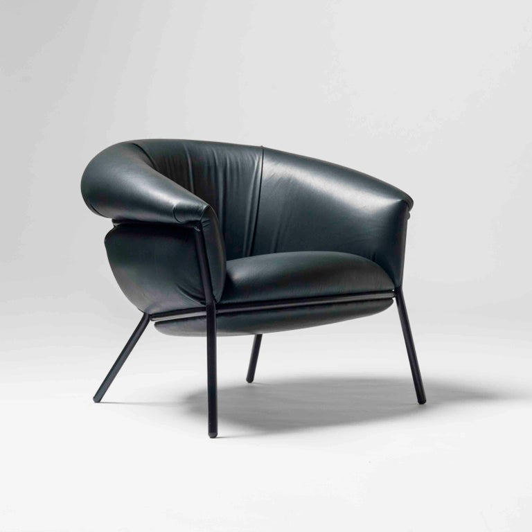 Armchair designed by Stephen Bruks manufactured by BD Barcelona.  An iron tubular (25mm) structured armchair. Seat and backrest upholstered in leather.  The leather upholstery oozes over the bare iron structure to contrast with the most
