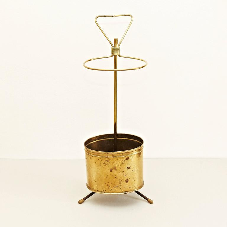 Umbrella Stand designed by Mathieu Matégot. Manufactured by Ateliers Matégot (France), circa 1950. Umbrella Stand in Bronze.  In good original condition, with minor wear consistent with age and use, preserving a beautiful patina.  Mathieu