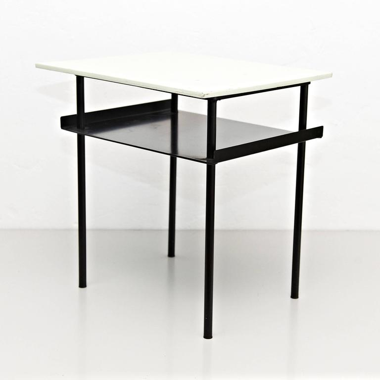 Coffee Table designed by Wim Rietveld around 1950, manufactured in Netherlands.  Lacquered metal frame and wood top.  In good original condition, preserving a beautifull patina.