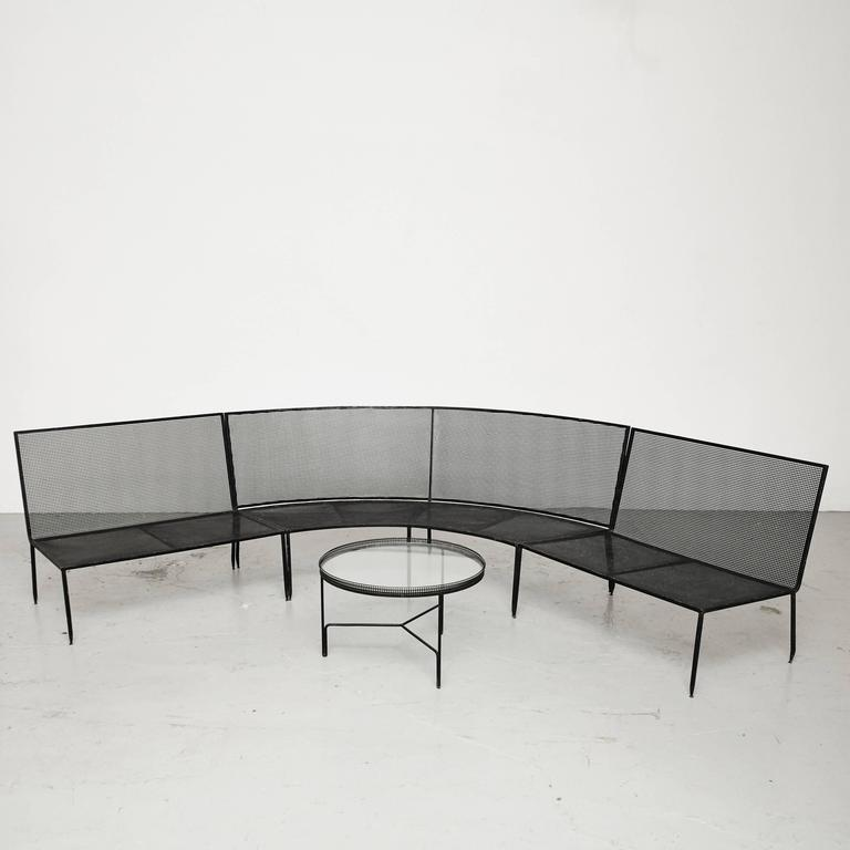 Large sofa and coffee table designed by Mathieu Mate´got, manufactured by Ateliers Mate got in France, circa 1950.