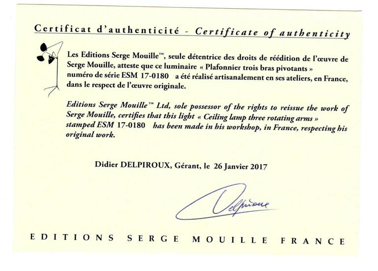 Three arms, one rotating ceiling sconce lamp designed by Serge Mouille or collection Serge Mouille.  Made by hand in Mouille's original workroom 1000 exemplar of each model per year.   The certificate shown on the photo is just an example, each lamp