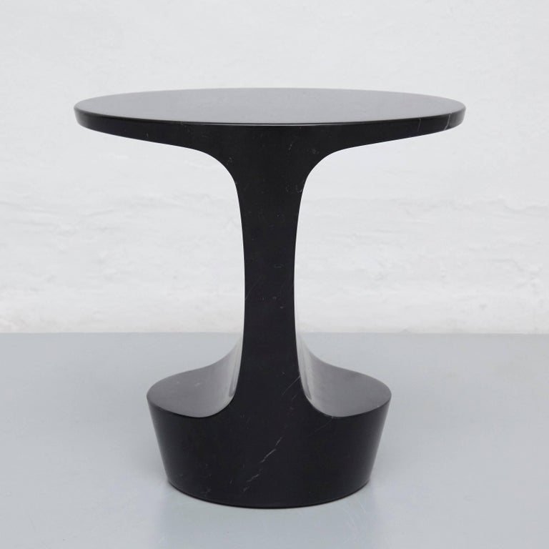 Side table designed by Adolfo Abejon.  Material: Marquina marble or Carrara marble.  Finish: Artisan polished.  Colors: Marquina black or Carrara white.  Dimensions: 42 × 32 × 43 cm (L × W × H).  The Marble of the piece will be different for each