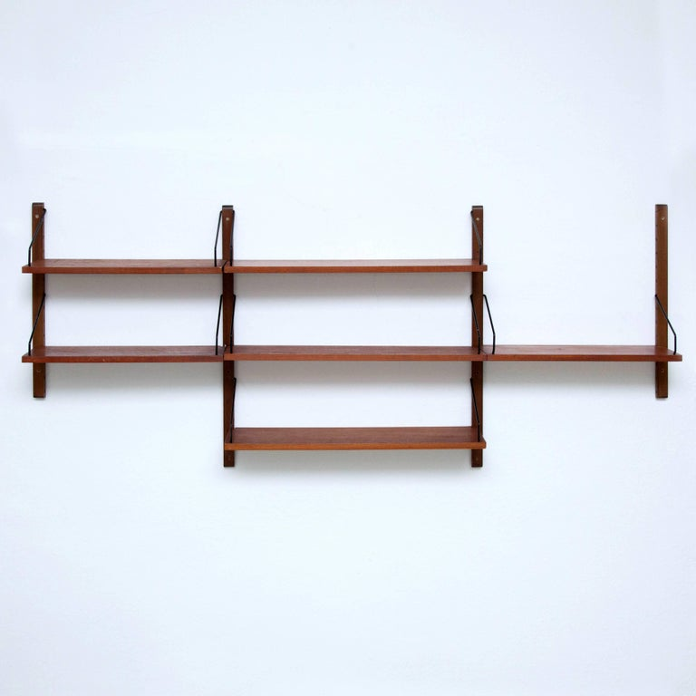 'Royal System' wall shelves system designed by Poul Cadovius, 1948. Manufactured by CADO in Denmark.  It possible to fit multiple shelves together.  In good original condition with minor wear consistent with age and use, preserving a beautiful