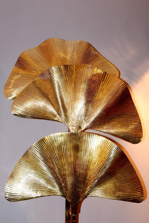 Ginko Biloba floor lamp in polished brass with three leaves.