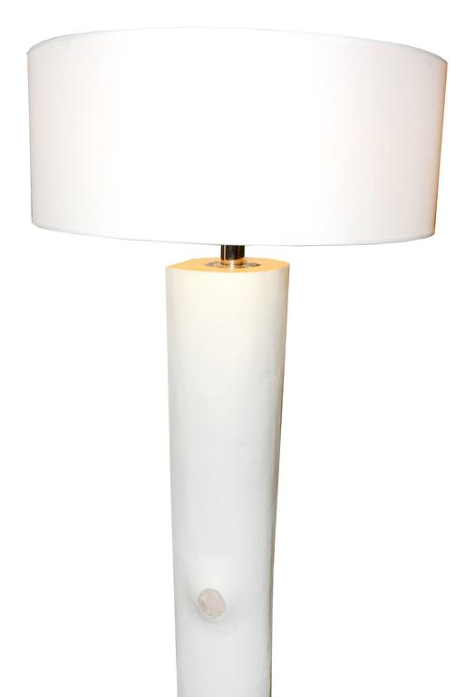 Floor lamp with softwood trunk covered with white genuine leather. White lampshade.