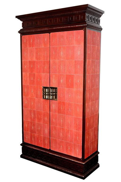 Cabinet Galuchat rouge set of two in solid mahogany and red genuine sharkskin, double handles nickel-plated copper, with interior shelves with central cushion in fabric and  interior lights. Exceptional piece. Set of two cabinets available. Unit
