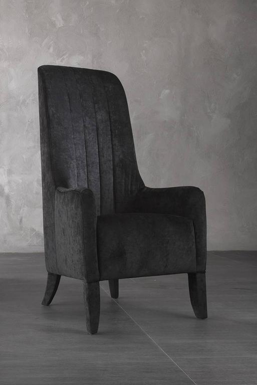 Armchair Ramses in fabric Cat A. with wood structure. Available with genuine leather Cat C. price: 6800,00€