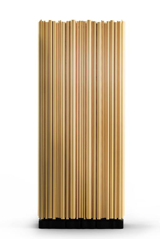 Cabinet brass tubes with polished brass tubes gold-plated  that wrap an exotic wooden structure, creating a clever juxtaposition.
