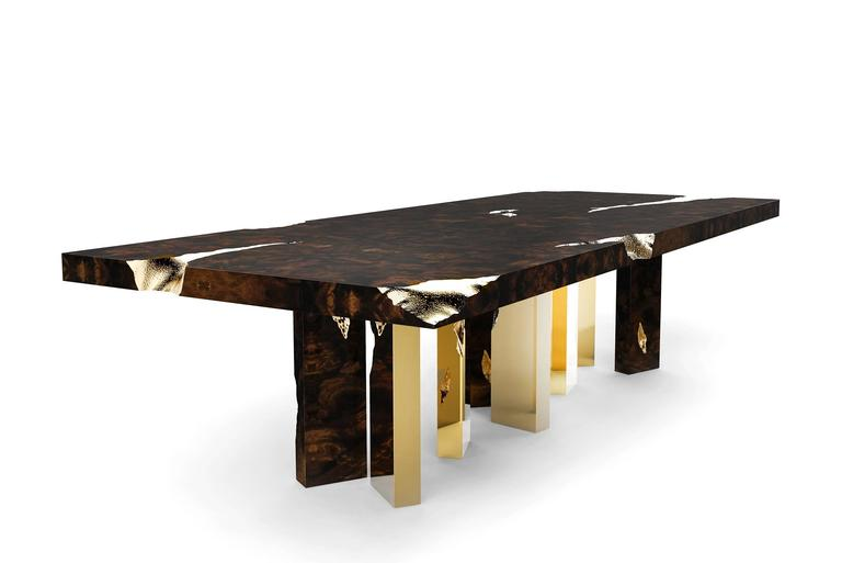 Dining table Majestic with solid mahogany coated in fine  wood venner details are in polished brass and brass sheets.  Exceptional piece. Price 33500,00€. Also available with base only with all feet in polished brass. Price: 43800,00€.