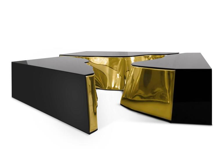Coffee table Paradise features a mahogany structure  with its inside finished in polished brass, exterior  finished in polished stainless steel.