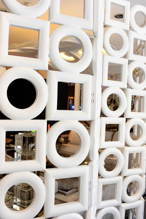 Folding screen rounds and squares is white matte painted in wooden structure. Designed by Pierre Cardin in 1970. Exceptional piece.
