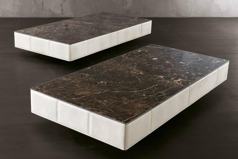 Rectangular coffee table Walter A quilted structure with leather category C. Top in marble. Top available in leather, glass or customer's choice. Structure is quilted with leather Cat. B or C. Can be made with customer dimensions and finish.