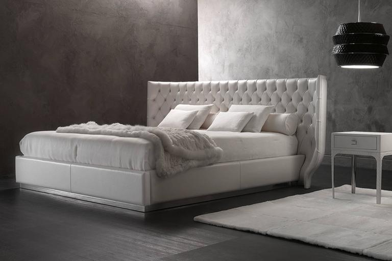 Bed Agra for slat 180. Box made with fabric category A. Headboard made with fabric A matelasse Steel or bronze support of box. Available: For slat 160. with leather category C and D. Night table in lacquered or leather finish.