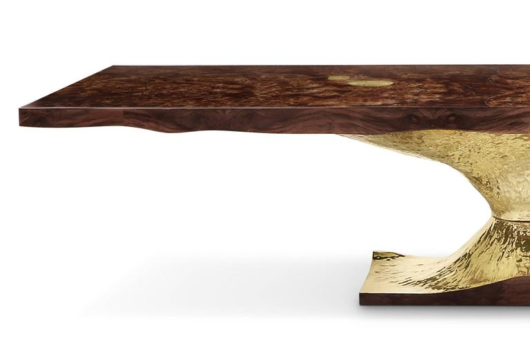 Dining or conference table gold tree with a walnut root veneer top which include fossils textured details. Base is in high polished brass. Exceptionnal piece. Pacific Compagnie collection.