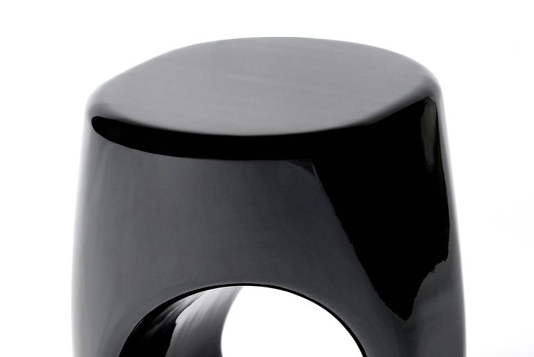 Stool black lacquered made in fiberglass, lacquered in black with high gloss finishing. Available in gold lacquered.