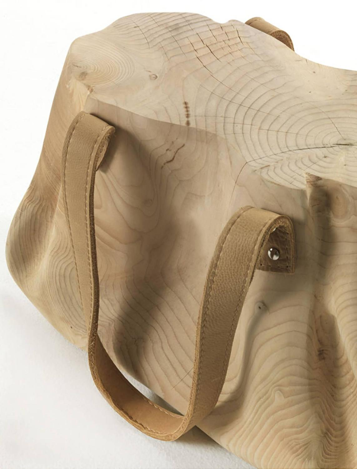 Bag stool in solid natural cedar wood hand carved with