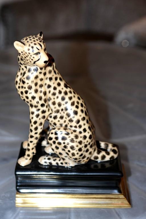 Indonesian Cheetah Bookends Set of Two in Porcelain with Brass Base For Sale