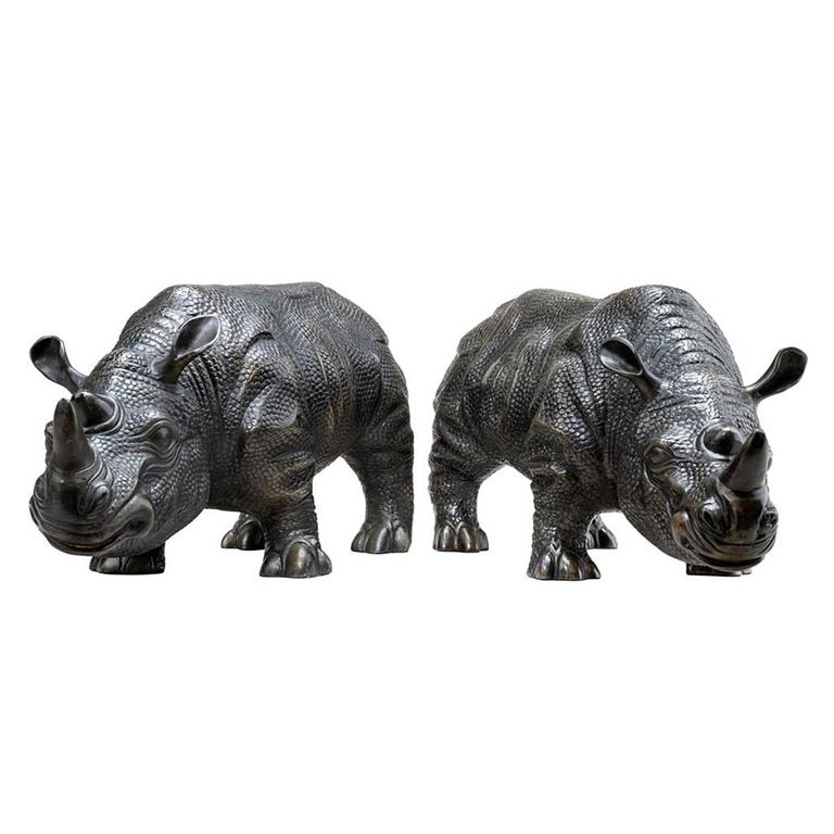 Set of two sculpture Rhinoceros in bronze highlight finish.