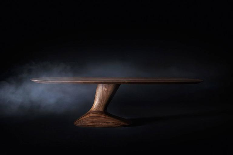 Dining table racing in solid walnut wood made of smoothed edges and glued lists. With asymmetrical lateral base Natural wax of vegetable origin with pine extracts finish. L 240 x D1 20 x H 75cm, price: 15500,00€ L 260 x D120 x H 75cm, price: