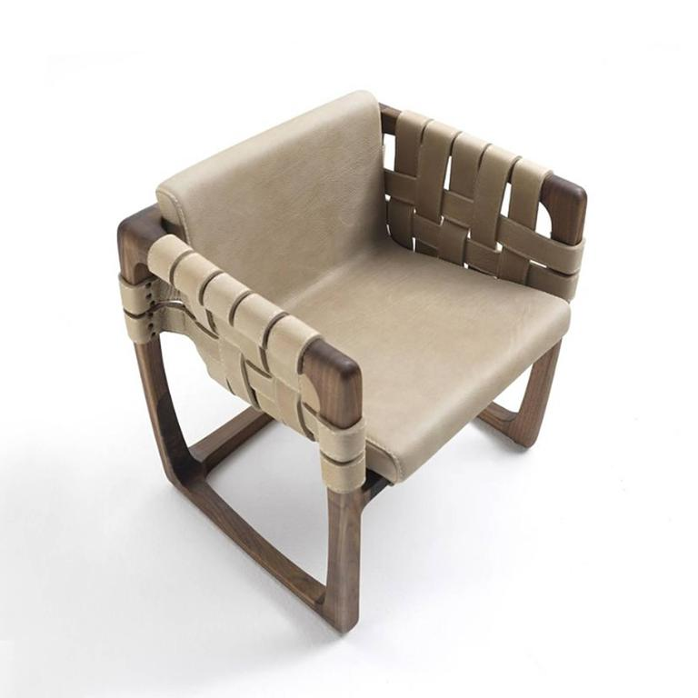 Chair webbing padded with structure in solid  walnut wood with upholstered seat covered with nubuck genuine leather.