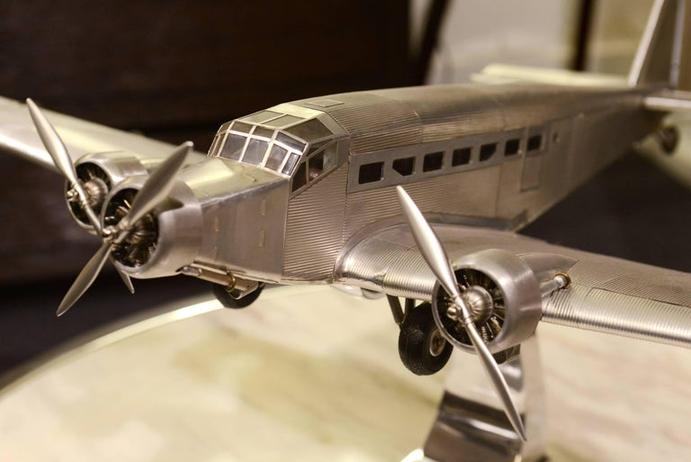 Reduced Model Junker JU-52 scale model, handcrafted in aluminium foil with engraved  metal rivets, 1932.