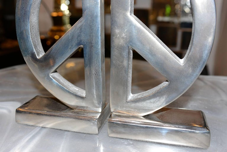 Contemporary Peace and Love Set of Two Bookends in Aluminium For Sale