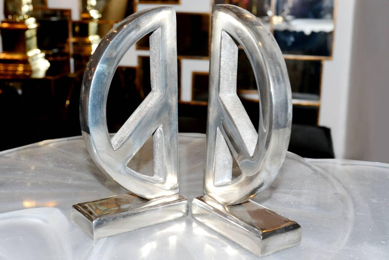 Polished Peace and Love Set of Two Bookends in Aluminium For Sale