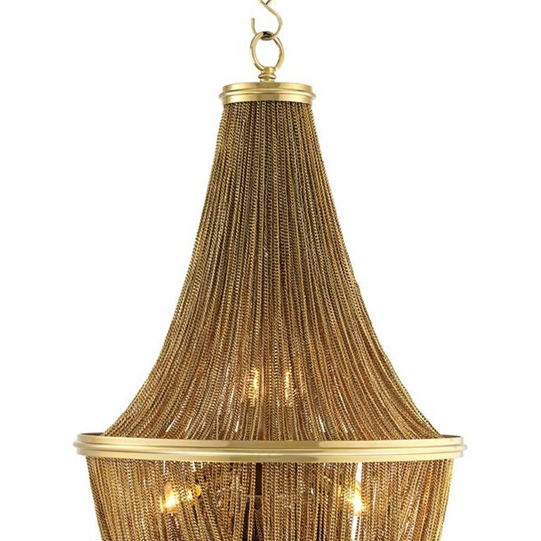 Round chandelier Grand Hotel with structure in  gold tones finish. With gold tones hanging chains. Six bulbs, lamp holder type E14, max 40 watt. Bulbs not included. Adjustable chain: 100cm. Also available in nickel finish. Also available in