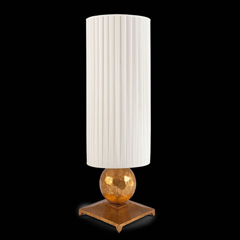 Table lamp turner in oro nero gold finish like beaten gold. With off-white pleated shade. CE standard.